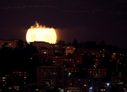 A supermoon rises in the sky at the city of Vina del Mar